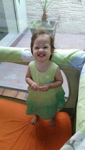Gabyta fits in a light green dress
