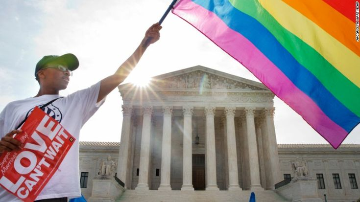 Carlos McKnight of Washington waves a flag in support of same-sex marriage outside the U.S. Supreme Court on Friday, June 26.