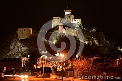 Night view on the illuminated castle in Trencin - the town in western Slovakia.