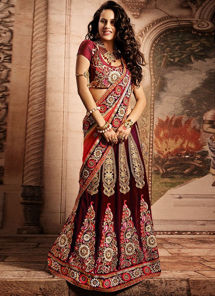Shop this product from here.. http://www.silkmuseumsurat.in/maroon-resham-work-velvet-lehenga-choli?filter_name=4630  Item :#4630  Color : Maroon Fabric : Velvet Occasion : Bridal, Party, Reception, Wedding Style : A Line Lehenga Work : Applique, Embroidered, Kasab, Patch Border, Resham
