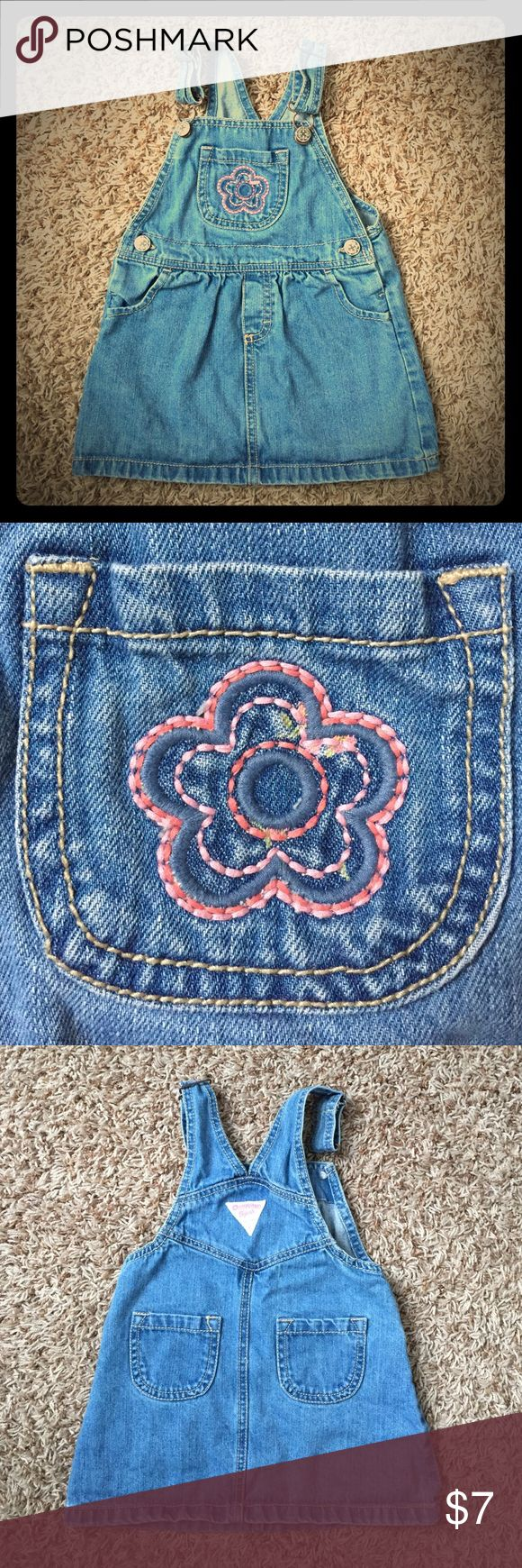 3T girls OshKosh denim overalls dress w/ flower Fun denim overalls dress for your little lady.  This looks super cute year round.  In the warmer months, just put a tank top of short sleeve shirt underneath.  In the colder months, layer a long sleeve shirt and leggings or tights.  This is so versatile!!!!  100% cotton Osh Kosh Dresses Casual