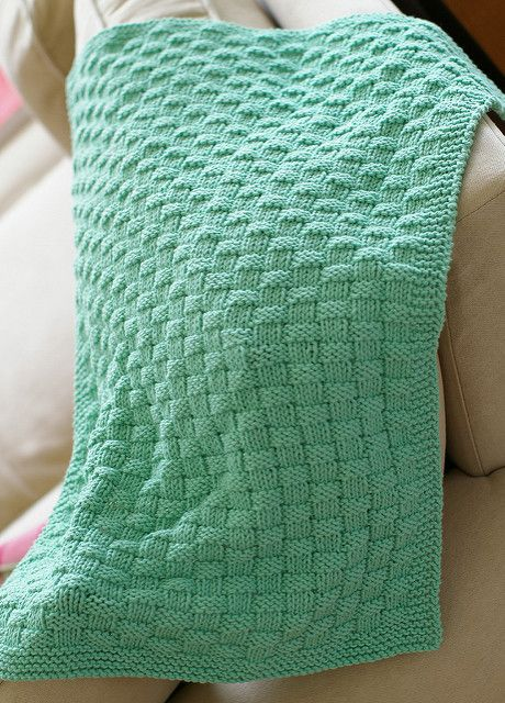 "Babies love textures, and who can blame them? This blanket uses a simple knit/purl basketweave stitch for extra depth. Beginners will find this not too challenging for a first ""fancy"" baby blanket, while more advanced knitters will quickly memorize the pattern and find it good for comfort knitting."