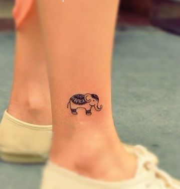 tiny elephant tattoo