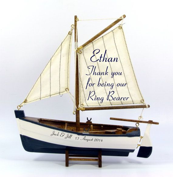 Model rowing/sailing boat that you can personalise to make a unique gift for your Pageboy or Ring Bearer.  As well as the thank you message on the sail we can add the couples name and the wedding date to the hull.  Because most young boys like pirates we have introduced a Pirate version. Like the classic version you can change the wording to suit but we try to keep it in pirate speak.  Please remember you are responsible for spelling!  Please be aware that this is not a toy and is for…
