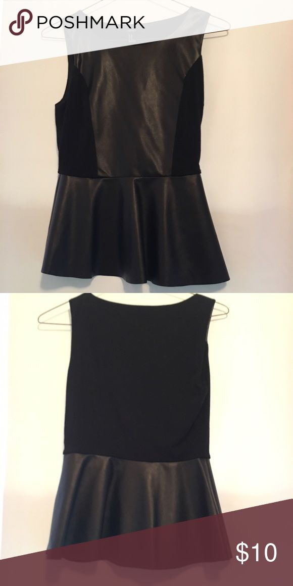 Black leather peplum top Black top with leather panels. Some pilling by the cotton part but not noticeable. Has a zipper oh the side. Forever 21 Tops Blouses