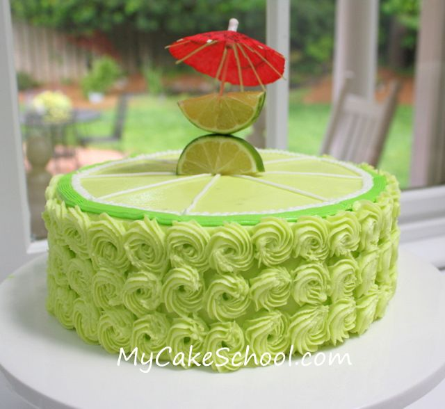 Here's the cake!  Lime Cake frosted in Lemon Lime Buttercream (aka Margarita Cake)!  I piped buttercream rosettes around the sides and made a big lime design piped on top!