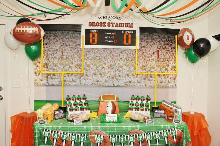 Dessert table and backdrop at a Football birthday party! See more party planning ideas at CatchMyParty.com!