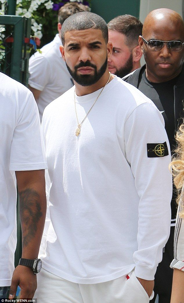 Rapper Drake, pictured at Wimbledon on Tuesday, has been a regular fixture at Serena's mat...