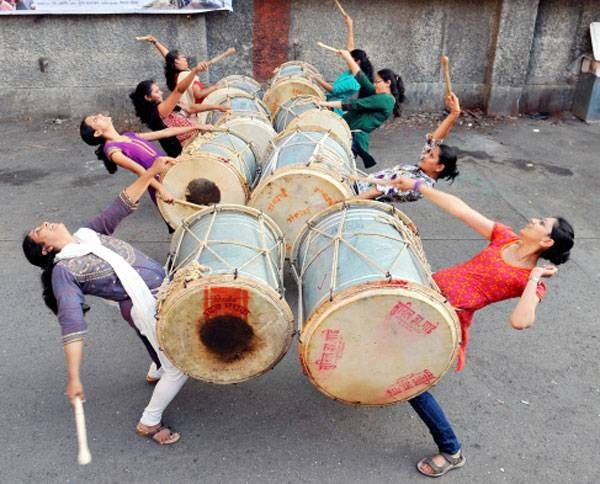 Girls practice with their dhols which is 8kg to 9kg in weight, for the rally procession in Mumbai to celebrate the Hindu New Year.