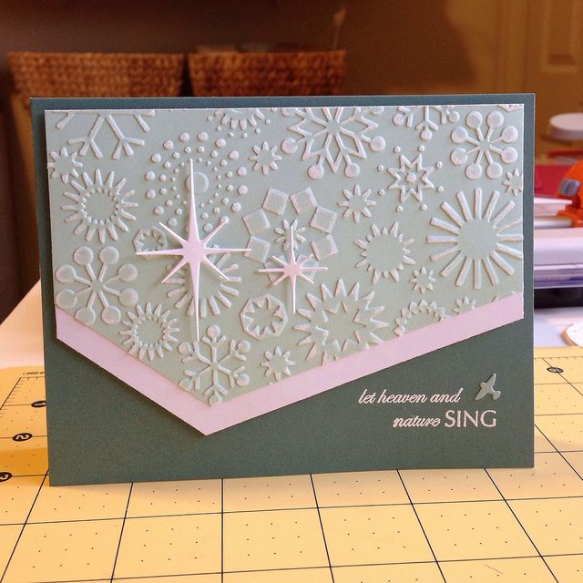 By Kim Akers. Christmas card. Uses Cuttlebug snowflake embossing folder, Memory Box stars & sentiment. I like the angular cut of the panels.