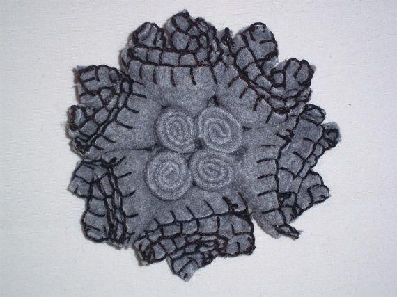Light grey felt flower brooch with grey felt rolls in the center