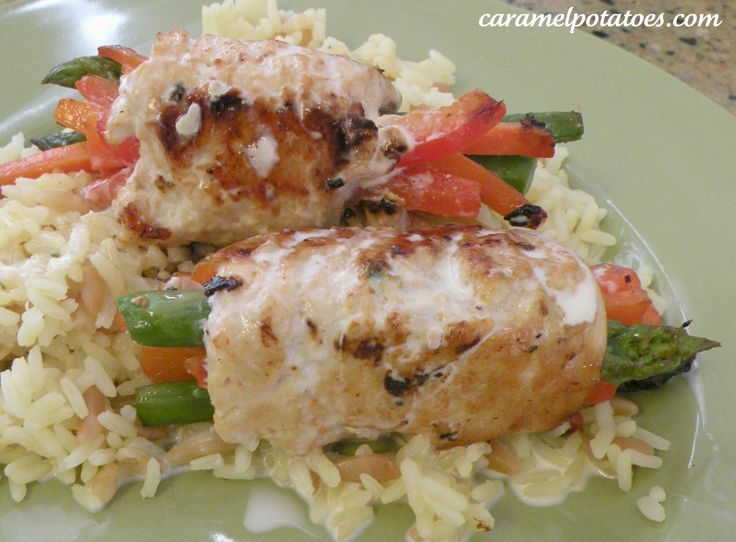 Chicken Bundles filled with Asparagus, Red Peppers, and Carrots - Topped with Rosemary Cream Sauce - Delicious and so cute!