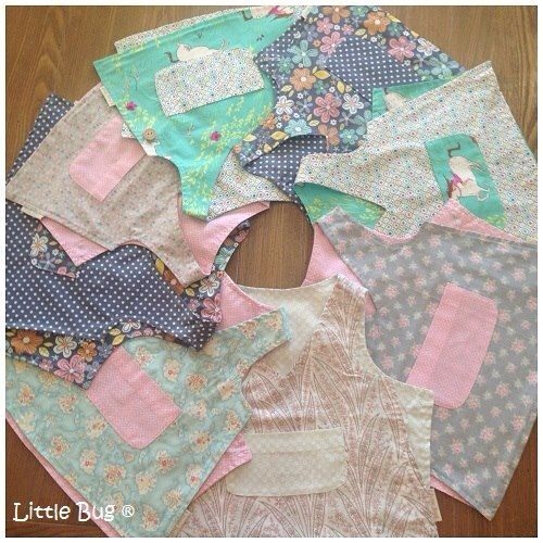 """Our very own """" Halle Vests"""" - made from designer cotton fabric, fully reversible with custom buttons AND 100% cute!!"""