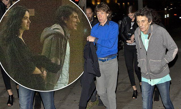 Ronnie Wood and his expectant wife Sally enjoy dinner with Mick Jagger
