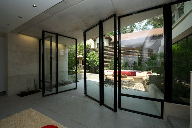 Rotating doors leading out to the courtyard.Houser Residence