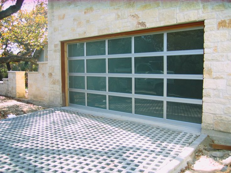 Beautiful stonework  grass   pavers  and a clear garage door  Perfect. 1000  images about Garage doors on Pinterest   Steel garage  Glass