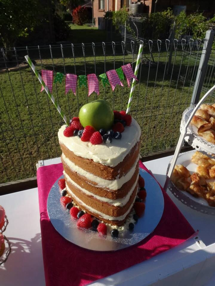 Nude cake with fruit and mini bunting. Apple of our eye