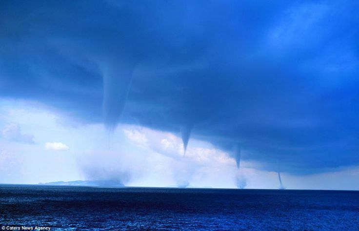 Waterspouts: Roberto Giudici captured these pictures while sailing off the Greek Island of Orthoni, in the Ionian Sea