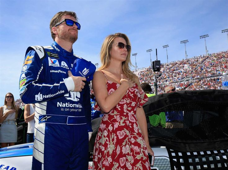 At-track photos: Las Vegas weekend  Sunday, March 12, 2017  Dale Earnhardt Jr. and his wife, Amy, stand on the grid before the start of the Kobalt 400.  Photo Credit: Getty Images  Photo: 28 / 71