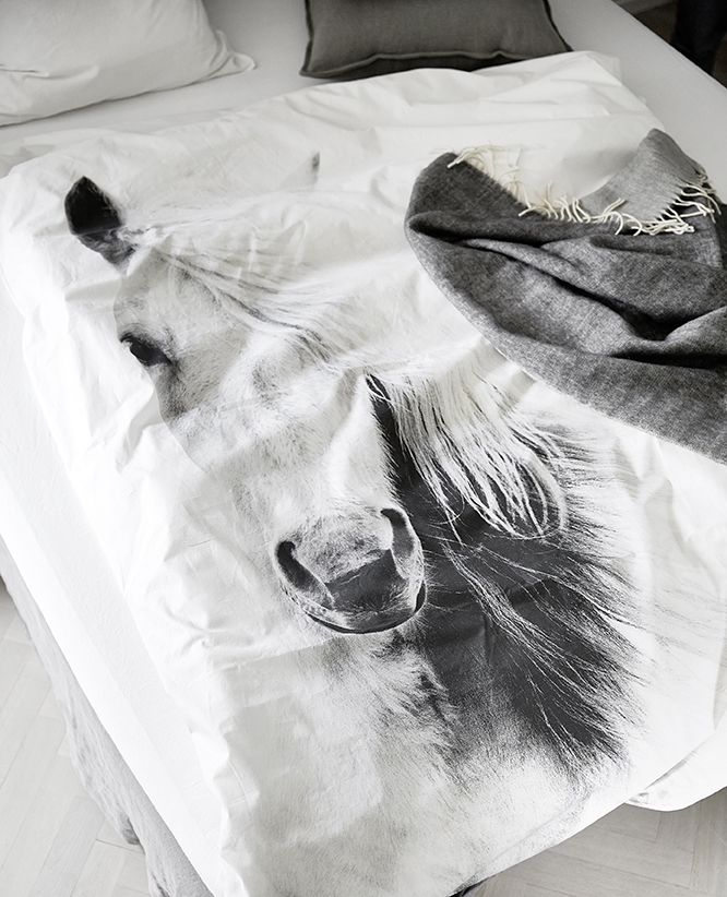 If you love horses, this bed linen in 100% eco certified cotton with a digital print of an Icelandic Horse is the perfect match for your bedroom. Throw in 100% wowen wool in grey/ charcoal...
