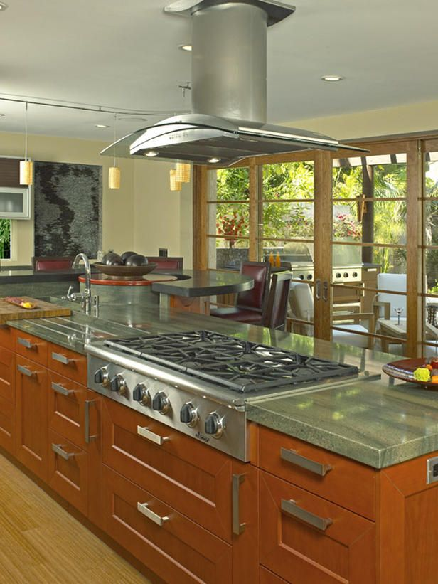 - Tour 10 Amazing Kitchens  on HGTV-love the island range hood, plus countertop stove top grill