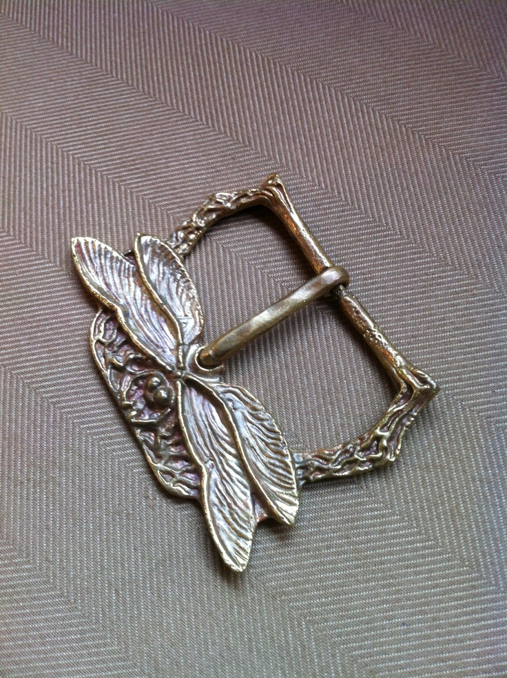 A dragonfly belt buckle