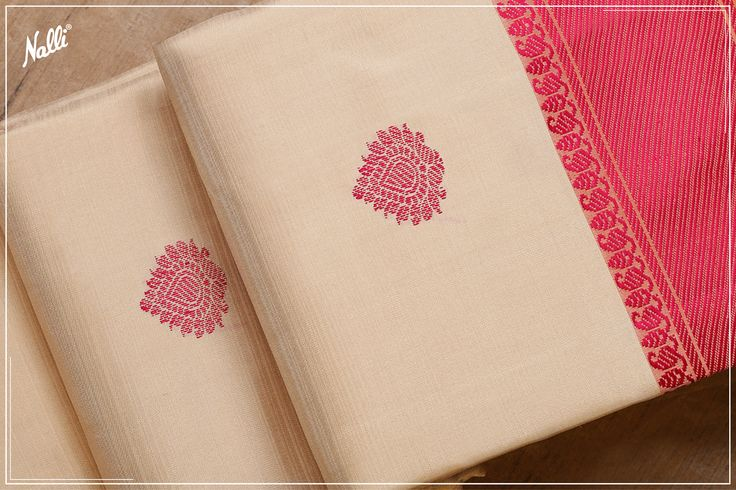 Biege and Pink Kanchipuram Silk Saree with thread motifs and pallu.