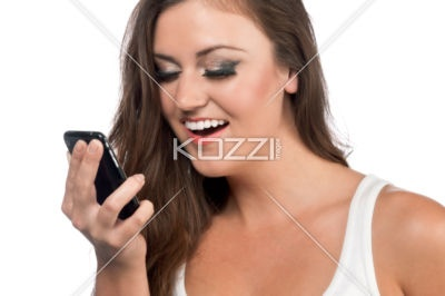 happy female model with phone - A horizontal image of happy female model holding a cellular phone on a white background