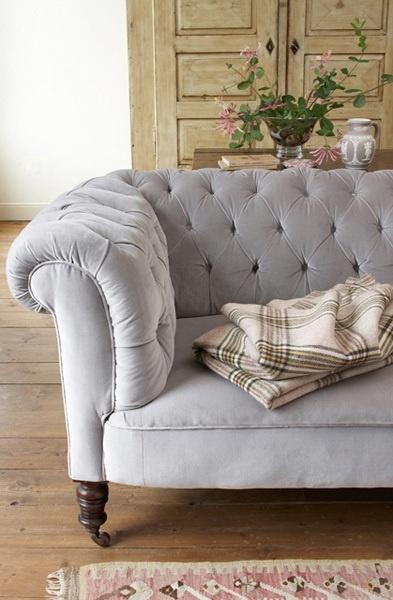 Grey tufted sofa.