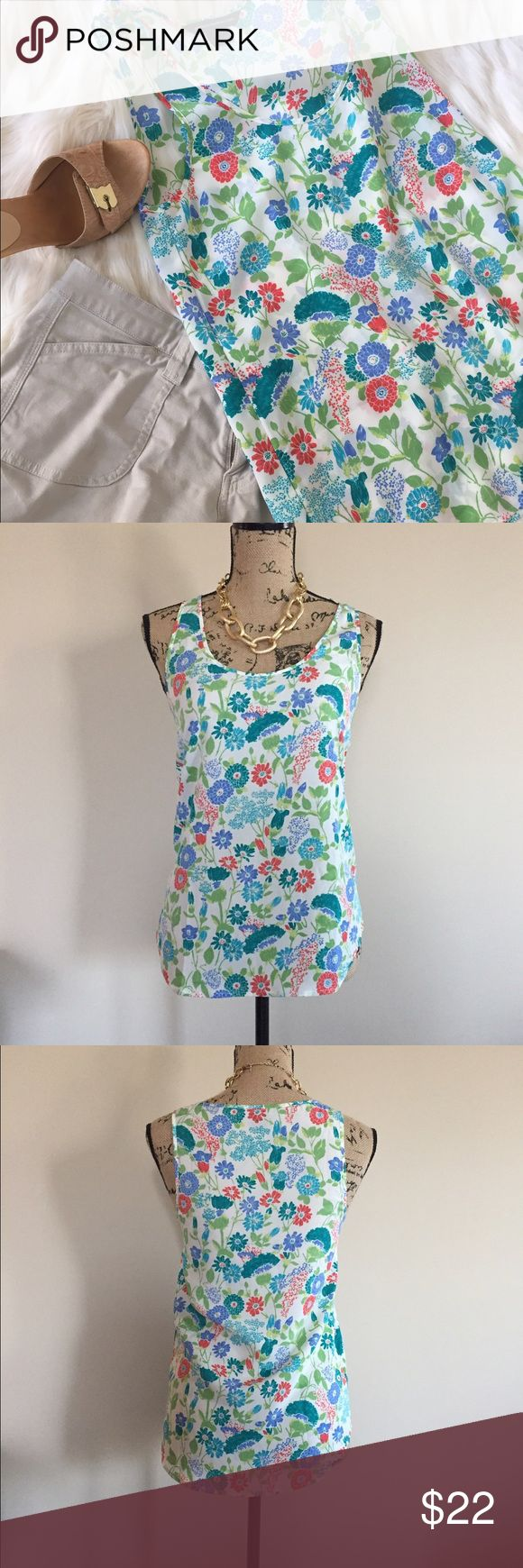"""☀️ French Connection blooming tank ☀️ NWOT Cute silky floral tank from French Connection. Perfect under a blazer to brighten up a work outfit!Scoop neck, round bottom hem. Size 2. 100% polyester. Bust measures 17"""", length 26"""". French Connection Tops Blouses"""