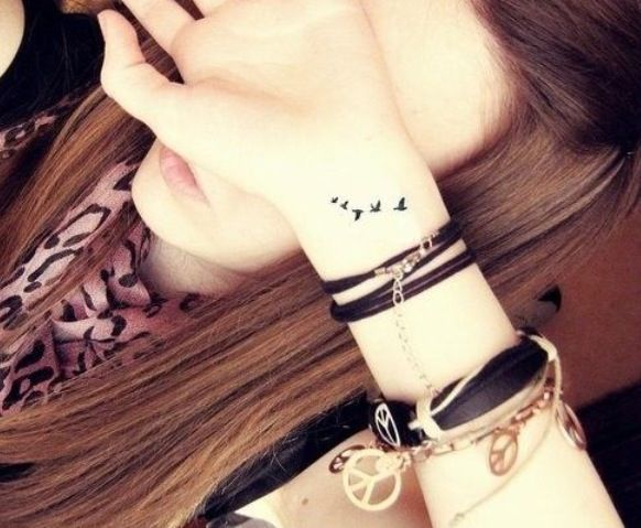 wrist tattoos 25 on Designs Next  http://www.designsnext.com/35-beautiful-wrist-tattoo-ideas/