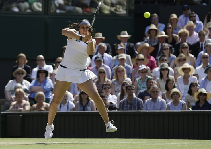 PHOTOS: Wimbledon Women's Final. Marion Bartoli of France returns to Sabine Lisicki of Germany during their Women's singles final match at the All England Lawn Tennis Championships in Wimbledon, London, Saturday, July 6, 2013. (AP Photo/Anja Niedringhaus)