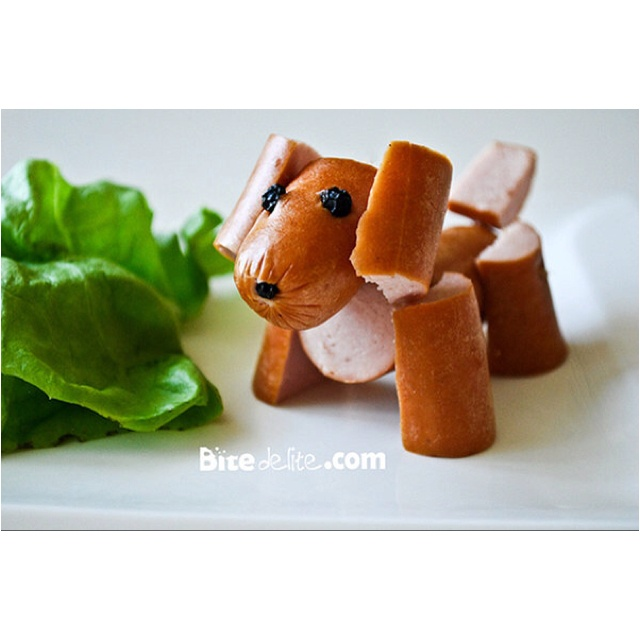 Hot Dog dog. Kids creative lunch. serve with a dab of mustard and ketchup and all set (when I made this for Eva and Emilie, I used the dog dish to their stuffed dog for the condiments! They kids loved the idea!)