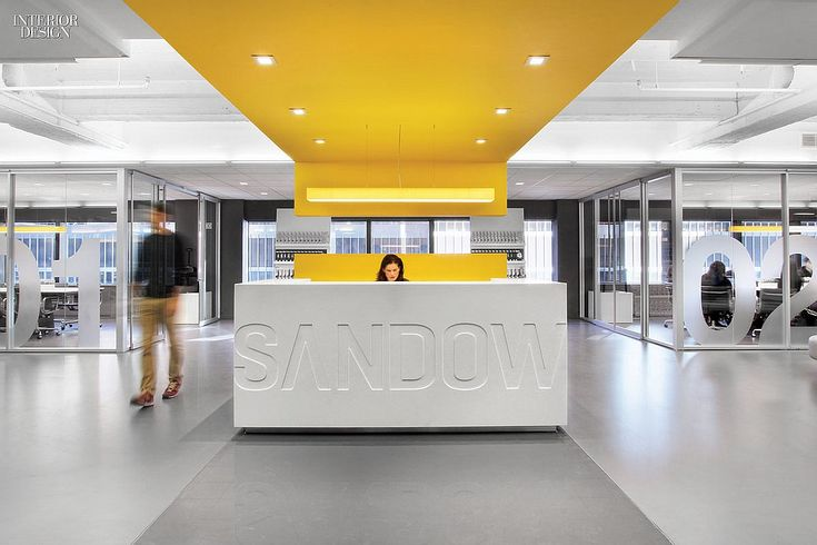 Corporate white reception desk + yellow striped ceiling