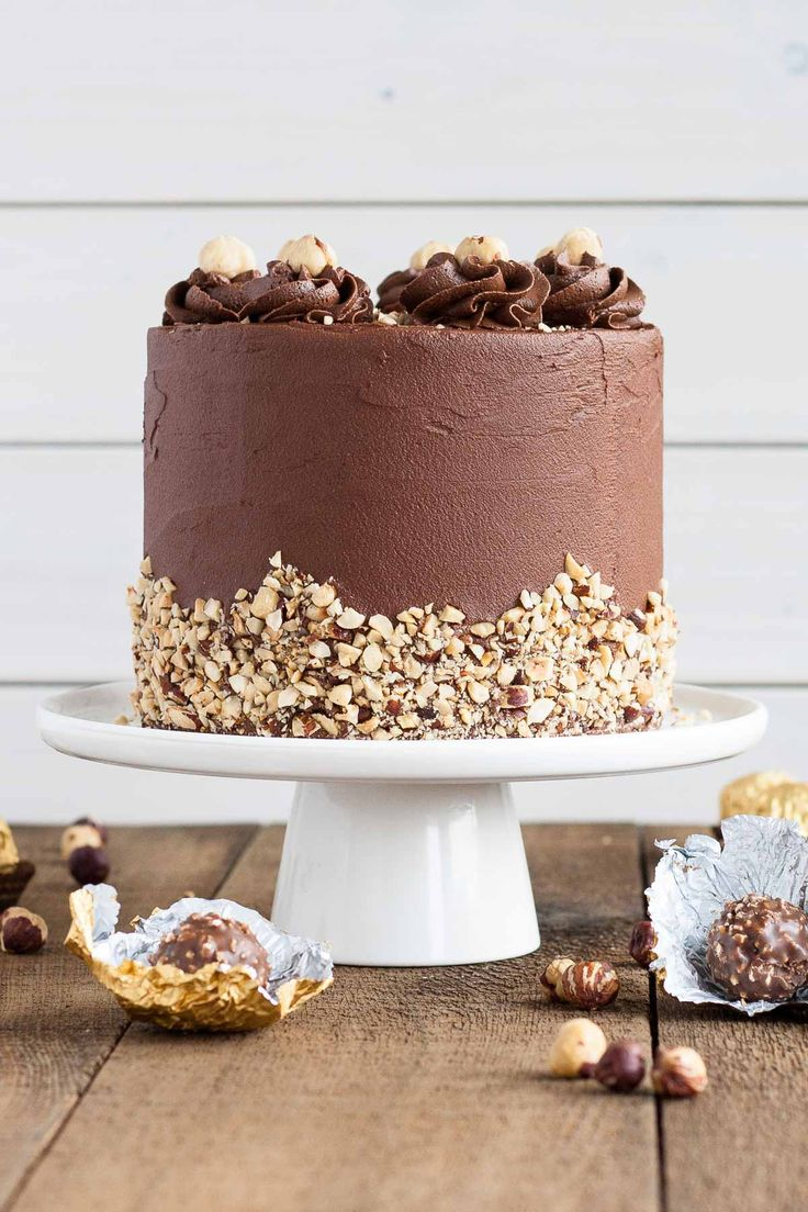 This Ferrero Rocher Cake is your favourite chocolate hazelnut treat in cake form! A delicious Christmas holiday party dessert recipe!