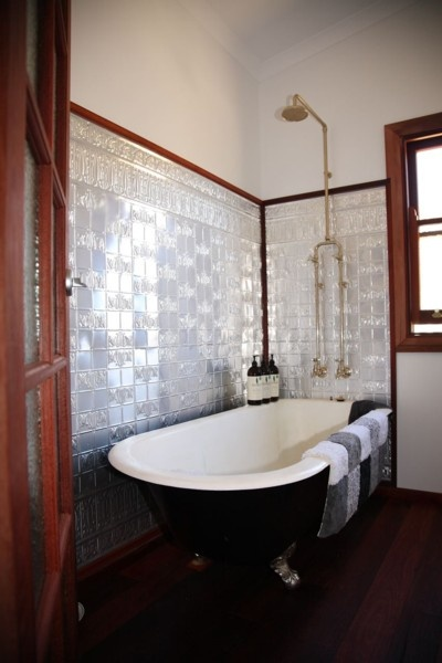 We're thinking something similar to this for our bathroom reno... Pressed tin wall panels rather than tiles?