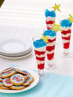 Star-spangled Parfait: Colorful layers of flavored gelatin and whipped cream give our light and tasty dessert its banner good looks.    For four servings, make one box each of red and blue gelatin according to the package directions. In tall, clear glasses, alternate layers of red gelatin and whipped topping (we used Cool Whip), as shown. Top with the blue gelatin. Finish with a slice of star fruit.