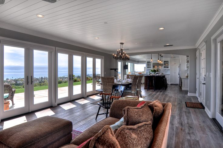 Classic Kitchen Dining Area & Family Room: traditional, classic, beach architecture, beach style, beach organic, stained wood Island, painted wood ceiling, painted crown molding, Ornamentation, Trim, paint & stained cabinets, painted raised  panel cabinet doors, glass panel cabinet doors, open shelves, farm sink, stone countertop, steel oven hood, recessed can lights, pendant lights, traditional chandelier, French doors, Dutch door, fireplace with wood mantel, arched wall, natural wood…