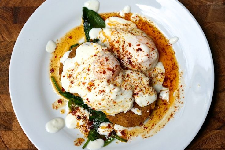 Poached eggs with yoghurt, spicy butter, wilted spinach and chickpea fritters... Turkish cilbir