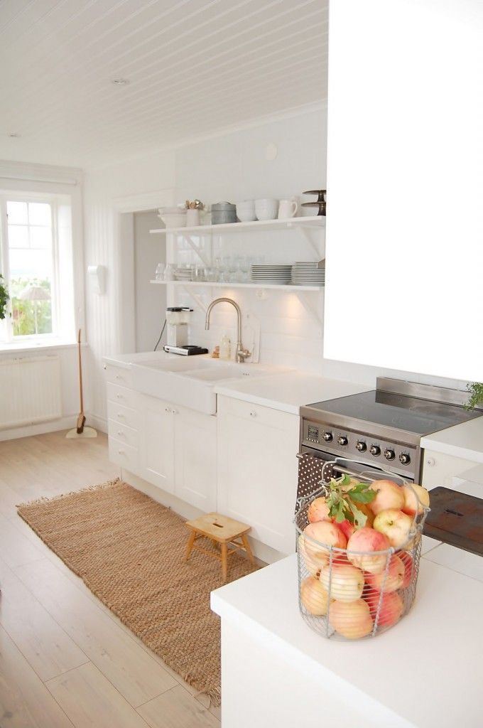 makes me want to paint my kitchen cabinets white again and I super love the natural rug/runner.