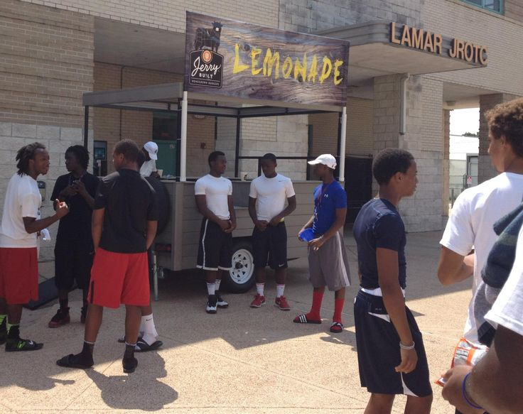 Donating refreshing lemonade at the Lamar High School football scrimmages.