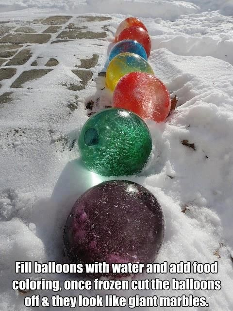Fill balloons with water (add food colored if desired) and set outside during the winter or a cold snap!!  Once frozen, remove the balloon, then place them around the yard/porch like giant marbles!