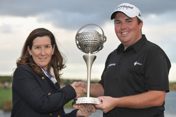 Shane Lowry is presented with the Portugal Masters trophy