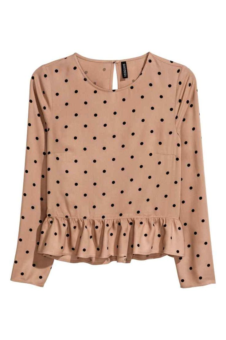 Blouse with a flounced hem: Long-sleeved blouse in a viscose weave with an opening with a button at the back of the neck and a frill trim at the hem. Slightly longer at the back.