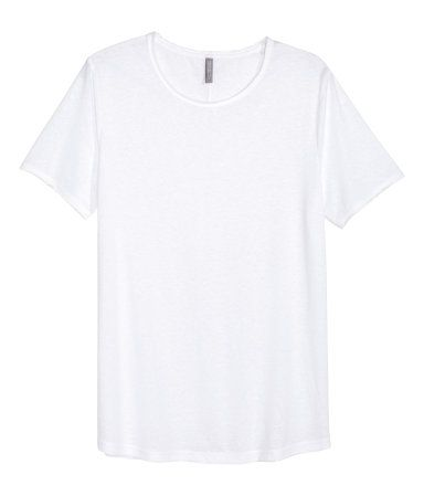 White. T-shirt in slub jersey with raw edges at neckline and sleeves and a seam…