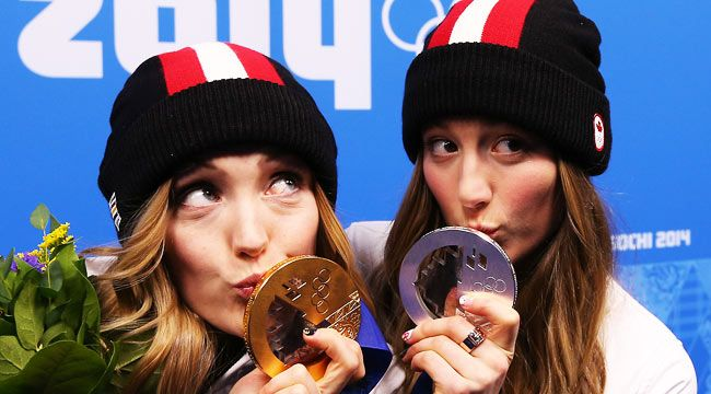 Canada's gold medallist Justine Dufour-Lapointe (L) and her sister, silver medallist Chloe Dufour-Lapointe pose during the medal ceremony for women's moguls @ 2014 Olympic Winter Games 2014