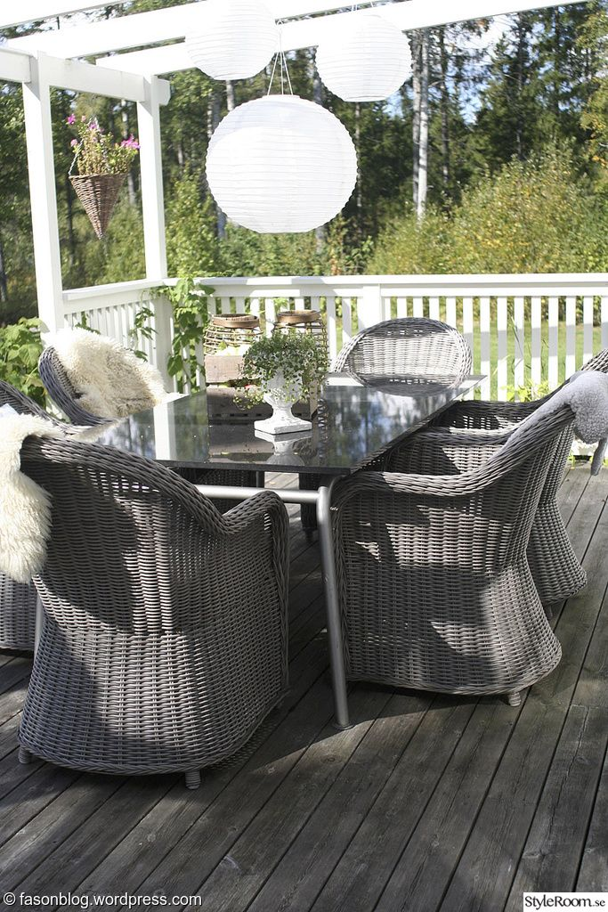 Late summer with rustic wicker chairs on deck