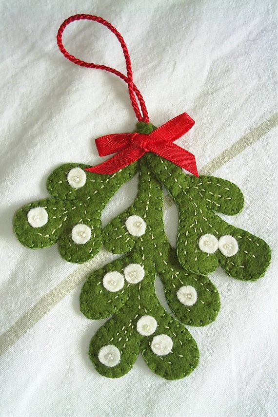 Make this christmas special with handmade tree decorations that will last for may years to come.  I have carefully handcut this mistletoe out of a double thickness of quality green felt, then blanket stitched around each branch, so they are really sturdy. Handcut the 10 or so small white felt berries and stitched them into place with a tiny white bead in the centre which catches the light. Then the 3 branches are stitched together at the top and a red/gold/green or gingham ribbon bow is…