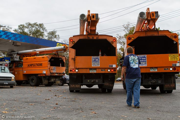 Asplundh, a tree service company from Florida, stops to get gas at the Sunoco on Mamaroneck Ave in Mamaroneck. This fleet of four trucks is only part-way through it's approximately 3 day drive to Boston to help with tree removal from power lines in that area. (Oct 29, 2012)