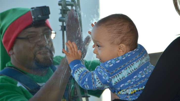 Window-washing Santa, elves surprise patients at Nemours Children's Hospital: Window-washing elf Ed Meza has a close encounter with Matthew Santos, who will be celebrating Christmas as well as his birthday at Nemours Children's Hospital in Orlando, Florida.